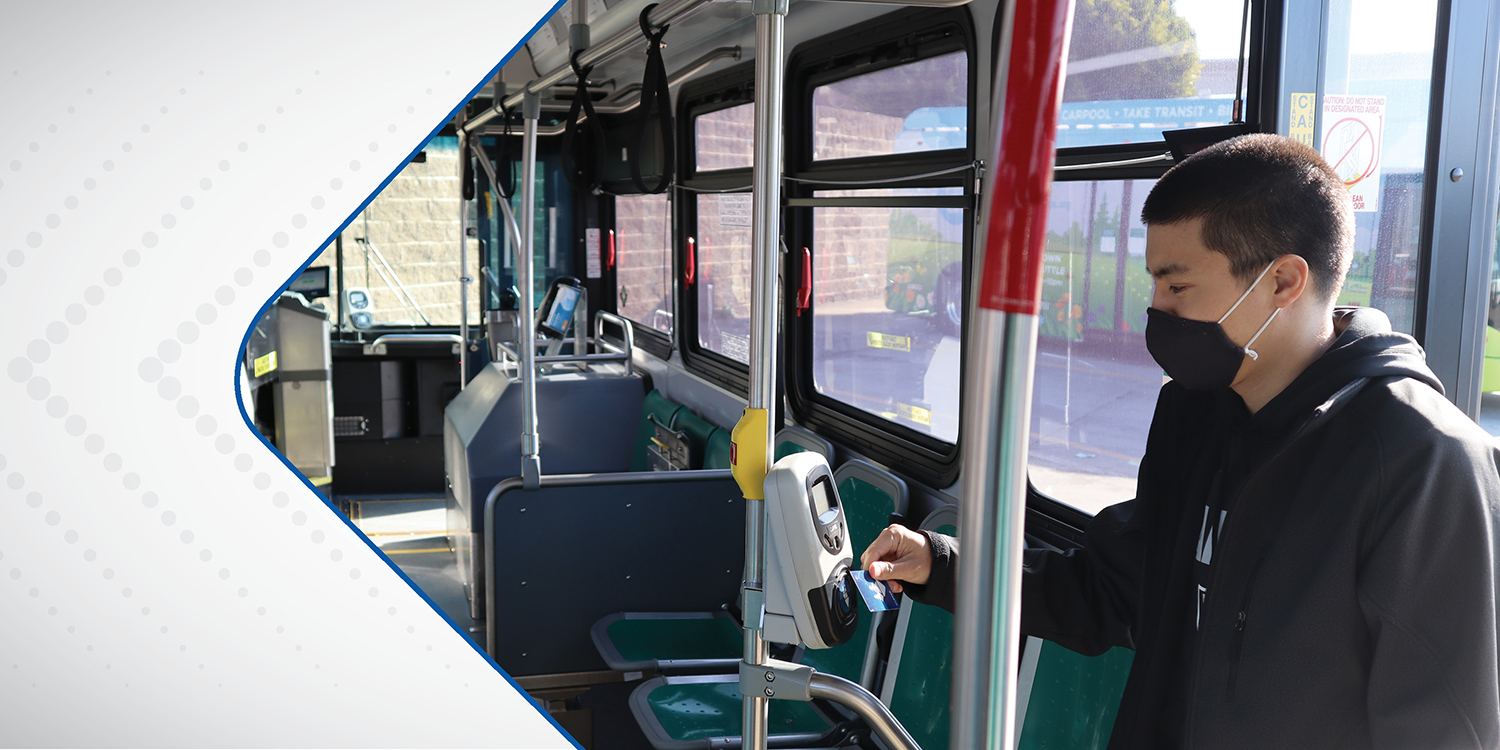 Man scanning Clipper Card at rear entrance of AC Transit bus
