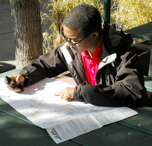 A photograph of someone planning at transit trip with a map.