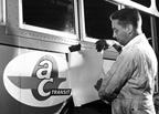 The AC Transit emblem replaces the Key System emblem in October 1960 on a 1300 series bus.